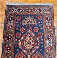 Sale 8735 - Lot 66 - A Persian woollen runner in geometric pattern on blue ground and red border 298 x 89cm