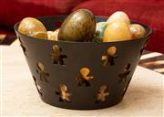 Sale 8882H - Lot 70 - An Alessi bowl with assorted decorative eggs made from various stone examples