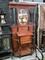Sale 8576 - Lot 1027 - Late Victorian Carved Oak Hallstand, with oval mirror, above a panel door & stick stands