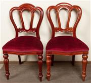 Sale 8871H - Lot 150 - A vintage set of 10 Admiralty back mahogany dining chairs C: 1970s. The shaped backs onto claret velvet upholstered serpentine fron...