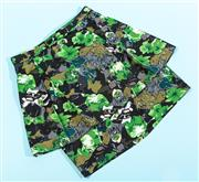 Sale 9090F - Lot 50 - A FLORAL LILI PEPLUM SKIRT; with panels and zip up back presnting a green boanical print, size S