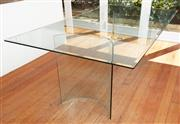 Sale 9081H - Lot 28 - A rectangular bevelled edge glass top dining table over two semi circle glass supports, Height 74.5cm x Length 200cm x Width 110cm