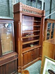 Sale 8728 - Lot 1083 - Large Gothic Style Cedar Bookshelf, the cornice with pierced quatrefoils above recessed graduated shelves, two shield panel doors be...