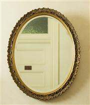 Sale 8418A - Lot 20 - An oval bevelled edge mirror in gilt frame, H 69 x W 55cm