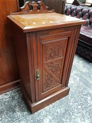 Sale 8792 - Lot 1046 - Late C19th / Early C20th Kauri Pine and Silky Oak Bedside Cabinet, with low carved back and floral carved panel door (H: 85 W: 43cm)