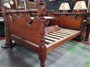 Sale 8576 - Lot 1048 - 19th Century Cedar Four Poster Double Bed, with scrolled headboards, framed by turned columns