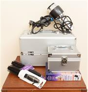 Sale 8855H - Lot 312 - A metal cosmetic travel case, together with a small metal jewellery box, a hairbrush and a hairdryer