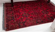 Sale 9023H - Lot 61 - A small Afghan Mahamadi carpet with four repeating starburst pattern in red tones 143X 100cm