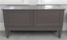 Sale 9256H - Lot 73 - A grey two panelled door cabinet raised on short baluster legs, enclosing shelved interior, H 77cm x W 140cm x D 48cm