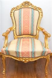 Sale 8338A - Lot 98 - A carved and gilt Louis style armchair with striped floral upholstery, H 106cm