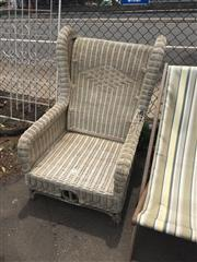 Sale 8676 - Lot 1189 - Large Wing Back Outdoor Wicker Chair