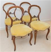 Sale 8341A - Lot 77 - A set of four Victorian pierced and carved walnut balloon back chairs with mustard velvet upholstery