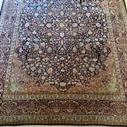Sale 8510A - Lot 36 - A woollen Persian carpet with profusely decorated floral design on a blue ground, 292cm x 212cm