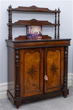 Sale 9256H - Lot 25 - A Victorian walnut etagere cabinet with carved panelled doors, between pilaster uprights opening to reveal a shelved interior, H 140...