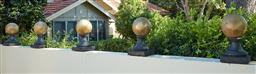 Sale 9097H - Lot 3 - An array of five Golden Globes in painted concrete. Height 50cm.
