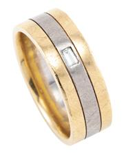 Sale 8899 - Lot 388 - A GENTS 18CT TWO TONE GOLD DIAMOND RING; 8mm wide triple band set with a baguette cut diamond, size U, wt. 13.83g.