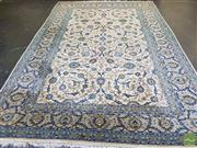 Sale 8500 - Lot 1007 - Nain Wool Carpet, with blue lotus arabesques on a cream field (380 x 280cm)
