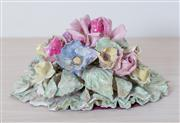 Sale 8430 - Lot 16 - A ceramic floral arrangement ornament (some damage). Height 22cm.