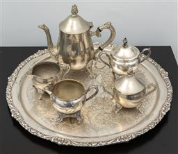 Sale 9256H - Lot 33 - A group of silver plated tea wares comprising; coffee, milk and sugar, with another milk and sugar, on an embossed, engraved tray, D...
