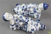 Sale 8594D - Lot 30 - Blue and White Pair of Chinese Porcelain Figures Reclining
