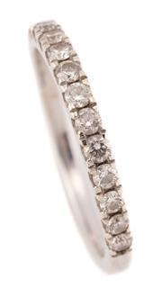 Sale 9095 - Lot 370 - A 9CT WHITE GOLD HALF HOOP DIAMOND RING; set with 13 round brilliant cut diamonds totalling approx. 0.45ct, width 2.5mm, size Q1/2,...