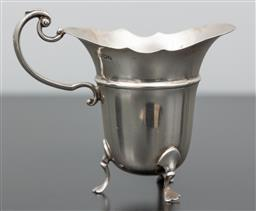 Sale 9256H - Lot 28 - A Sheffield sterling silver helmet formed three footed creamer, H10cm