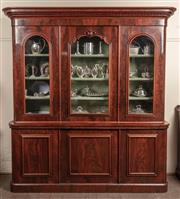 Sale 8871H - Lot 158 - A large antique English mahogany 2 part bookcase C: 1865. The glazed 3 door upper section lined in sage green felt to house books an...