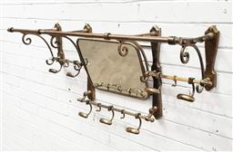 Sale 9126 - Lot 1082 - Brass Wall Mounted Coat Hanger, in the form of an antique compartment luggage rack, fitted with mirror (h:51 w:100 d:30cm)