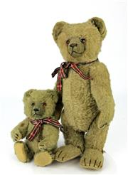 Sale 8330T - Lot 56 - Vintage Teddy Bear with Cub; 1920s possibly Bing, with glass eyes, wood wool stuffing, felt pads, growlers not working (7-11).