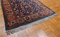Sale 8735 - Lot 84 - A small Persian woollen rug with Geometric Heriz floral pattern on blue ground with pink border, 164 x 107cm