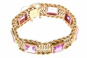 Sale 8534 - Lot 324 - AN 18CT GOLD STONE SET BRACELET; 17mm wide rope and fancy link bracelet set with synthetic pink spinel and synthetic pink sapphires...