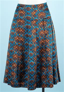 Sale 9091F - Lot 46 - A CITY DKNY PLEATED SKIRT; in brown and blue geometric pattern in a silk blend with zipper to side, Size US 6