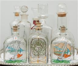 Sale 9256H - Lot 31 - A quantity of eight decanters including three Holmegaard examples, tallest H29cm.