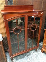 Sale 8666 - Lot 1016 - 1920s Maple Display Cabinet, having two astragal doors with round panels & cabriole legs