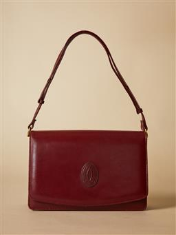 Sale 9093F - Lot 26 - A Burgundy rectangular shoulder bag by Cartier