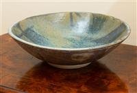 Sale 8735 - Lot 88 - A studio pottery bowl incised mark to base, OM? dated 1972, diameter 33cm