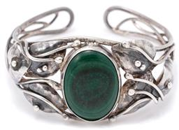 Sale 9149 - Lot 320 - A SILVER MALACHITE CUFF BANGLE; hand made in the Rhoda Wager style with leaf design centre rub set with an oval malachite, with 800...