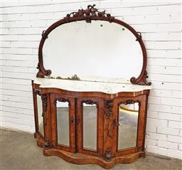 Sale 9085 - Lot 1080 - Victorian Figured Walnut Credenza, the arched fruit carved mirror above a white serpentine shaped marble top, with four carved mirro...