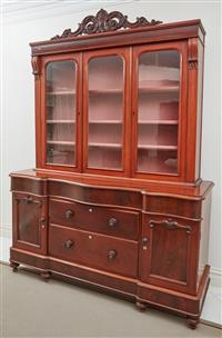 Sale 9090H - Lot 45 - A Mahogany display cabinet with three glazed doors to the superstructure, the earlier base with five drawers and two panelled doors...