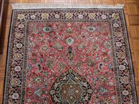 Sale 8735 - Lot 90 - A Cadrys pure silk Persian Qum carpet with central medallion red ground on a black border, certificate of origin sherikat Davoud Er...