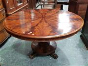 Sale 8792 - Lot 1018 - Victorian Mahogany Supper Table, with a round radial veneered top on a baluster pedestal, on a turned base on pawed feet (H: 74 D: 1...