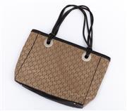 Sale 8800F - Lot 68 - An Oroton beige monogram canvas and dark brown leather trim handbag, H 29 x W 42cm