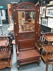 Sale 8848 - Lot 1005 - Early 20th Century Cedar Carved Hall Stand, with mirror back and hinged seat