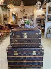 Sale 9087H - Lot 77 - An early 20th C  French Louis Vuitton steamer trunk. Covered in monogram canvas with leather trims and brass hardware. Original inte...