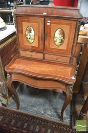 Sale 8317 - Lot 1003 - C19th Style Marquetry & Gilt Metal Mounted Ladys Desk with two painted panel doors & two drawers above a frieze drawer with writing...