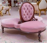 Sale 8430 - Lot 77 - A good Victorian carved walnut conversation seat in trefoil arrangement with button backs and seats upholstered in pink velvet, on c...