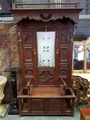 Sale 8576 - Lot 1062 - Early 20th Century French Breton Oak Hallstand, the overhanging top with turned gallery, above a (later) etched mirror, carved & tur...