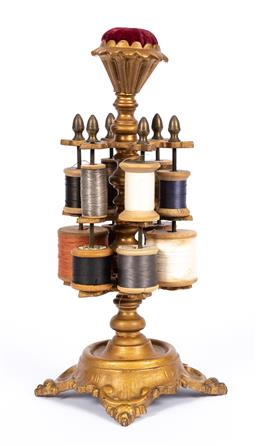 Sale 9190E - Lot 1 - A vintage cast metal thread spool holder with red velvet pin cushion to top, Height 28cm