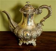 Sale 8418A - Lot 45 - A Victorian silver coffee pot with floral finial, the body heavily embossed with acanthus and floral design, with two shields, raise...