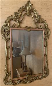 Sale 8510A - Lot 43 - A gilt  rococo style mirror, H x 107cm x W 64cm